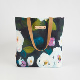 This is a white snap tote by Afton Harding called Montreal Garden.