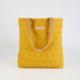 This is a yellow snap tote by Erika Firm called Espace Triangle.