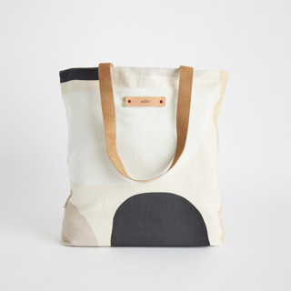 This is a grey snap tote by Iveta Angelova called Dreamland in standard.