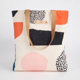 This is a pink snap tote by Iveta Angelova called Playground.