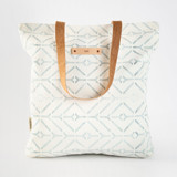 This is a white snap tote by Carolyn Nicks called Coastal.