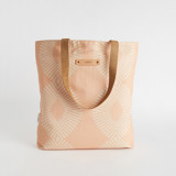 This is a pink snap tote by Tanya Lee Design called Eyelet Blush.