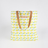 This is a yellow snap tote by Erica Krystek called Lemon Squeezy.