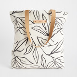 This is a black and white snap tote by Cass Loh called ink line leaves.