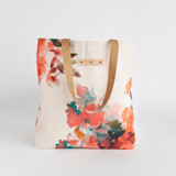 This is a pink snap tote by Lori Wemple called Floral Bouquet.