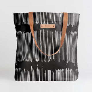 This is a black snap tote by Tanya Lee Design called Matchstick Black in standard.