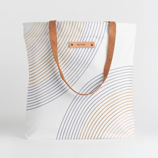 This is a beige snap tote by Erin German Design called Sunrise.