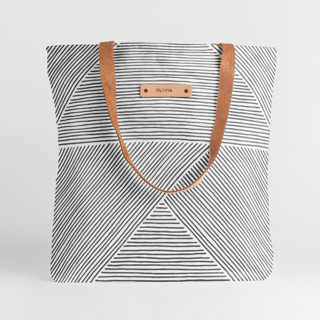 This is a grey snap tote by Michelle Taylor called Line Mix in standard.