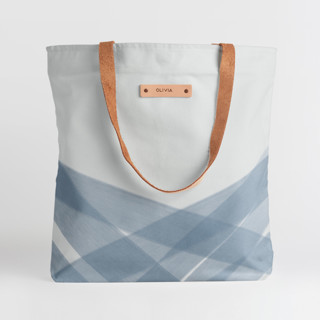 This is a blue snap tote by Roopali called Crisscross.
