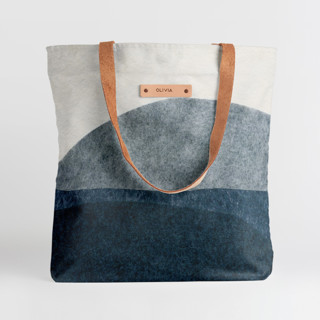This is a blue snap tote by Carrie Moradi called tissue overlay in standard.