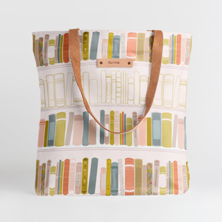 This is a beige snap tote by Three Sugars Creative called So Many Stories.