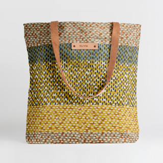 This is a yellow snap tote by Bethania Lima called Basic in standard.
