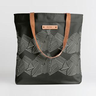 This is a black snap tote by Deborah Velasquez called Savanna Grassland.