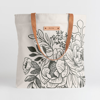 This is a black snap tote by Genna Blackburn called Etched Flowers in standard.