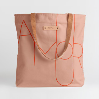 This is a pink snap tote by Morgan Kendall called Amour in standard.