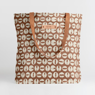 This is a brown snap tote by Carrie ONeal called Penny Thoughts in standard.