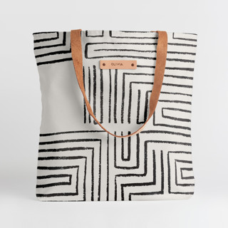 This is a black snap tote by Anna Elder called Taos in standard.