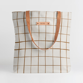 This is a brown snap tote by Carolyn Nicks called Montauk in standard.