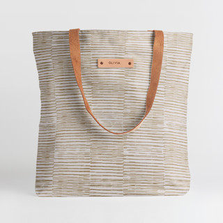 This is a brown snap tote by Alethea and Ruth called Dashed Stripes in standard.