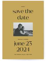 This is a yellow save the date postcard by Annie Clark called Artifact with standard printing on signature in postcard.