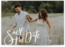 This is a white save the date postcard by Wildfield Paper Co. called Summertime Love with standard printing on signature in postcard.
