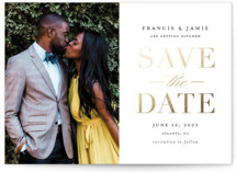 This is a white save the date postcard by Stacey Meacham called Simply Striking with foil-pressed printing on signature in postcard.