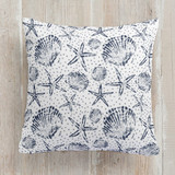 This is a blue pillow by Sarah Curry called Stamped Seashell printing on premium cotton.