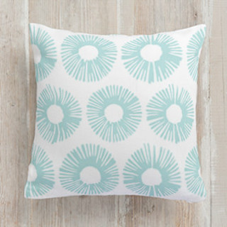 This is a blue pillow by Oma N. Ramkhelawan called Burst printing on premium cotton.