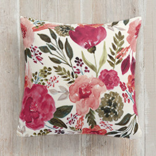 This is a white pillow by Beth Schneider called Flourishing Garden printing on premium cotton.