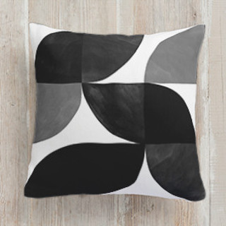 This is a black pillow by Heather Francisco called Mod Wedge printing on premium cotton.