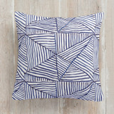 This is a blue pillow by Yaling Hou Suzuki called Line and Triangle printing on premium cotton.