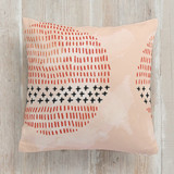 This is a black pillow by Jen Owens called wild printing on premium cotton.