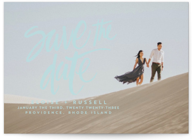 This is a landscape, portrait simple and minimalist, blue Save the Dates by Aspacia Kusulas called Lovely Brush with Standard printing on Smooth Signature in Classic Flat Card format. This save the date features a brushed hand lettering complementing your ...