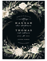 This is a black save the date by Susan Moyal called Ivory Ring with standard printing on recycled in standard.