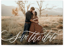 This is a white save the date by Wildfield Paper Co called Flourished Love with standard printing on signature in standard.
