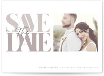 This is a grey save the date by GeekInk Design called Serifs with standard printing on pearlescent in standard.