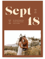 This is a brown save the date by April Astudillo called Bold Print with standard printing on doublethick in standard.