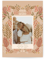 This is a beige save the date by Lauren Jinhee called Floral Folklore with standard printing on pearlescent in standard.