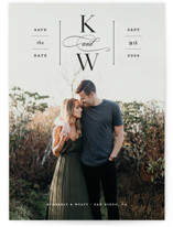 This is a black save the date by Carolyn MacLaren called Romantic Label with standard printing on triplethick in standard.