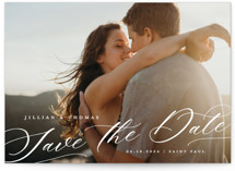This is a white save the date by Michelle Taylor called Slant with standard printing on pearlescent in standard.