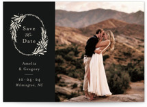 This is a black save the date by Laura Hankins called Heirloom Wreath with standard printing on recycled in standard.