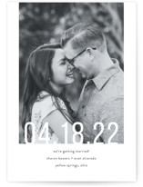 This is a black save the date by Up Up Creative called Date Check with standard printing on smooth signature in standard.