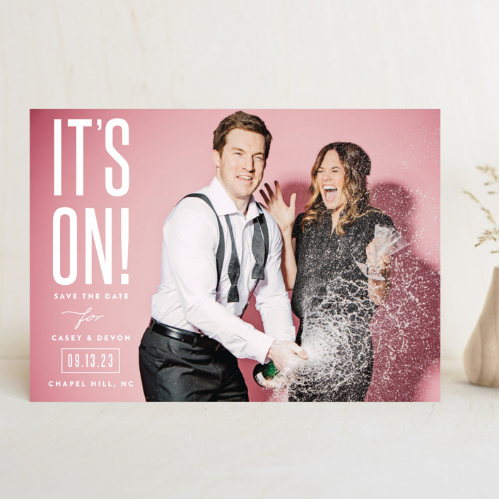 save the date card with bright backdrop