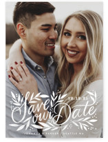 This is a white save the date by Alethea and Ruth called Leafy Lettering Script with standard printing on smooth signature in standard.