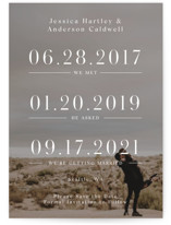 This is a white save the date by Mayflower Press called Timing with standard printing on smooth signature in standard.
