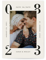 This is a grey save the date by Amy Kross called Cornered with standard printing on smooth signature in standard.