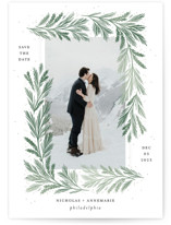 This is a green save the date by Paper Raven Co. called Frost Magic with standard printing on smooth signature in standard.