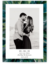 This is a blue save the date by Susan Moyal called Painted Sea Glass with standard printing on signature in standard.