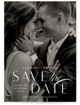 This is a white save the date by Everett Paper Goods called Swoop with standard printing on signature in standard.