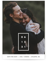 This is a white save the date by Chryssi Tsoupanarias called Cherished Date with standard printing on smooth signature in grand.